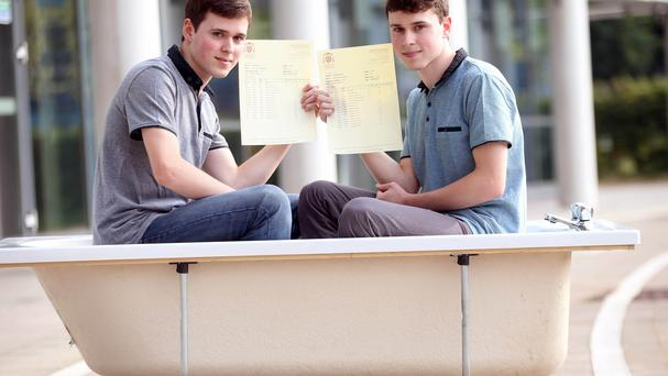Identical twins Rory, left, and Ryan Doolan got the same grades in the same subject (Coleg Y Cymoed/PA)