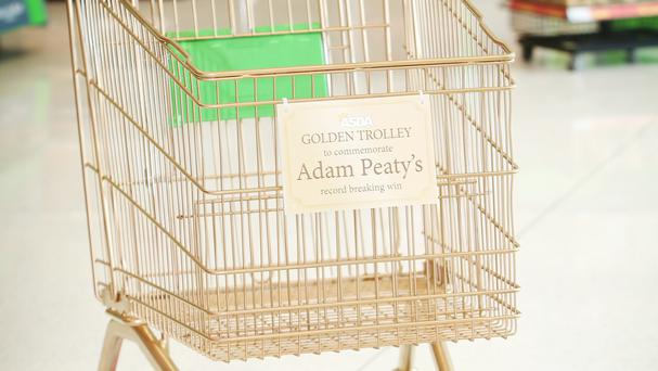 The trolley painted gold in honour of swimmer Adam Peaty (Asda/PA)