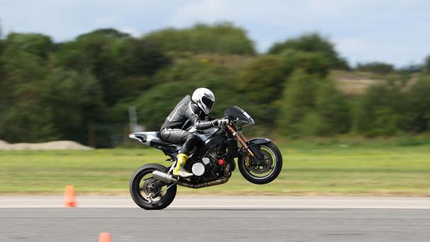 Egbert van Popta from the Netherlands becomes the new World Wheelie Champion at at Elvington Airfield, Yorkshire, where he established a new world record at 213mph
