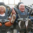Emily Barker, 71, and Tony Barrett, 80, celebrate the launch of the Old Age Coaster Pass at Thorpe Park Resort