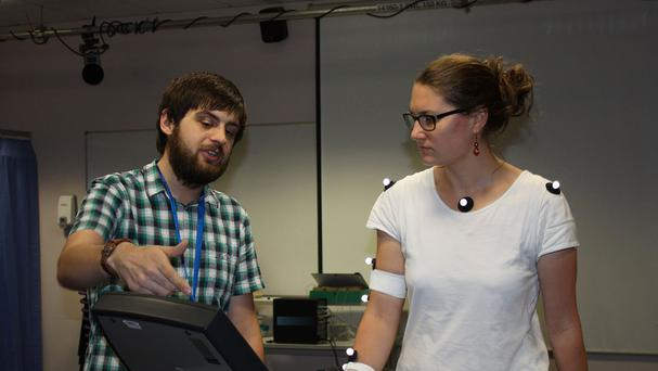 A researcher from the Department of Psychology at the University of Portsmouth with a participant in the study