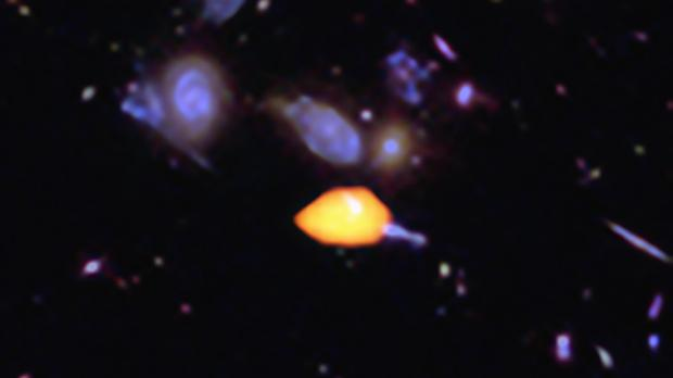 A close-up image reveals a galaxy rich in carbon monoxide, showing it is primed for star formation (B Saxton (NRAO/AUI/NSF)/ALMA (ESO/NAOJ/NRAO)/NASA/ESA Hubble/PA)