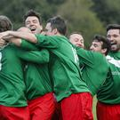 Andy Burnham celebrates with teammates as comedian John Bishop scores the winning penalty during a football match between Labour Party members and journalists