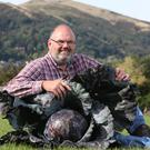 David Thomas has become a world record breaker at the National Giant Vegetable Championships, with his massive 23 kg cabbage.