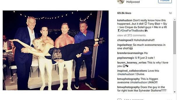 Tony Blair, actor Sylvester Stallone and two Cirque du Soleil acrobats lift Kate Hudson into the air at a party in Los Angeles (Instagram/PA)
