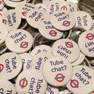 The badges are meant to encourage strangers to talk to each other on the London Underground (@tube_chat/Twitter/PA)