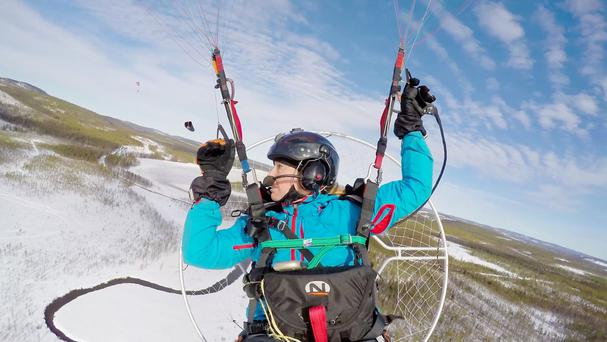 Sacha Dench is flying with the birds using just a parachute wing and a small propeller engine