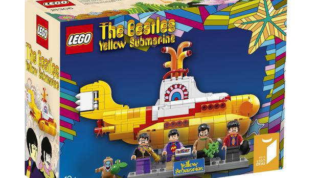 The 550-piece set allows fans to take a surreal trip under the sea in a yellow submarine (Legoland/PA)