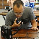Michael Herrera using a device called a Taste Buddy (Professor Adrian Cheok/PA)