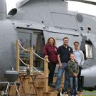 Martyn Steedman, his wife Louise and sons Josh and Harry on the steps of their retired Sea King helicopter