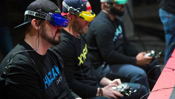 People taking part in a drone race (DRL)