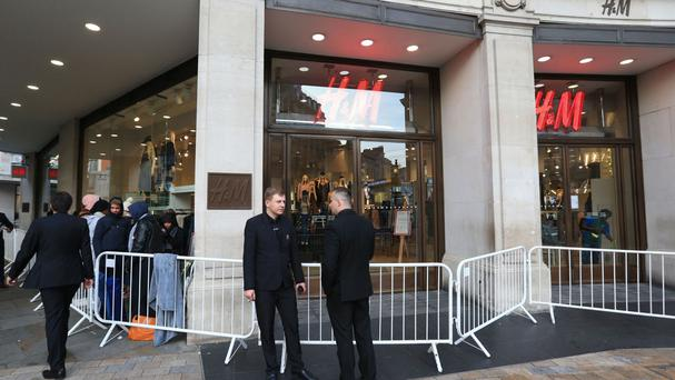 Security staff outside the H&M store on Oxford Circus, London, as the store's collaboration with Kenzo was due to launch