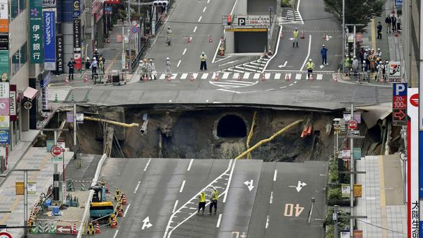 A massive sinkhole which opened in the middle of the business district in Fukuoka, southern Japan (Sadayuki Goto/Kyodo News via AP)