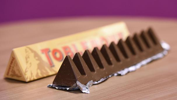 The new Toblerone, as the maker of the famous Swiss treat has changed its distinctive mountain peak shape and made bars lighter