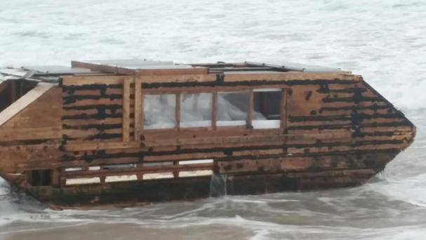 Photo taken with permission from the Facebook page of Ballyglass Coast Guard Unit of a makeshift solar-powered houseboat