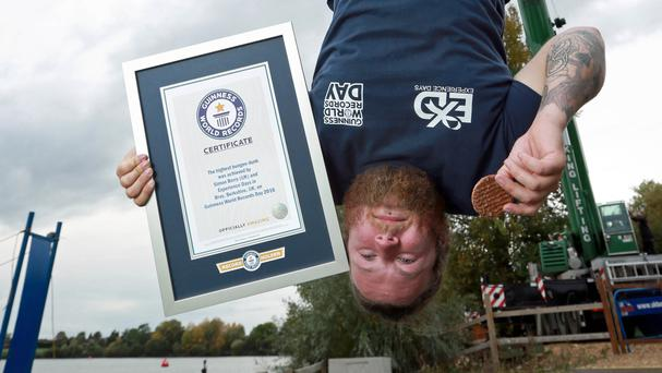 Simon Berry achieved the Guinness World Record for the highest dunk of a biscuit by a bungee jumper (Matt Alexander/PA)