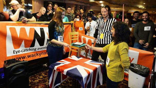 Competitors take part in the annual UK Rock Paper Scissors Championship, at the Green Man public house in the city of London.