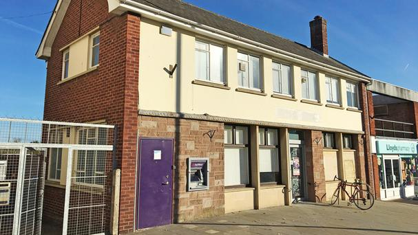 A former NatWest Bank premises in Heavitree, Exeter, which will be auctioned, complete with a fully functioning cash machine still in service (Clive Emson auctioneers /PA)