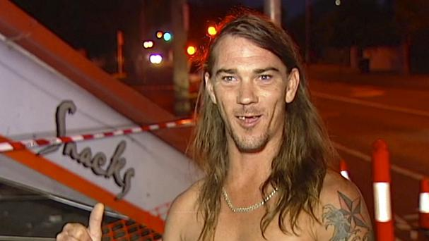 Daniel McConnell describes the scene of the car crash during a television interview (Australian Broadcasting Corporation/AP)