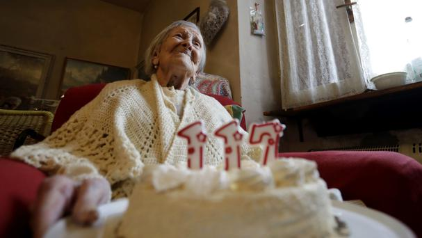 Emma Morano holds a cake with candles marking 117 years (AP)