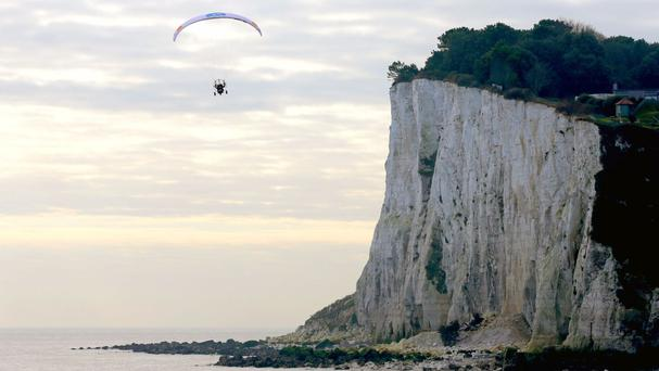Paramotorist Sacha Dench, the Human Swan, arrives in Dover