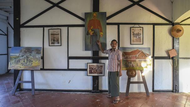 Amateur George Orwell scholar Nyo Ko Naing points to a portrait of a former British colonial official inside a planned museum in Katha, Burma (AP)