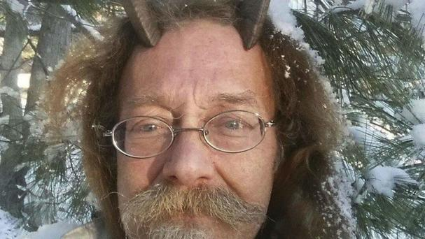 Phelan Moonsong has been given permission to wear goat horns in his driver's licence photo (Phelan Moonsong/AP)