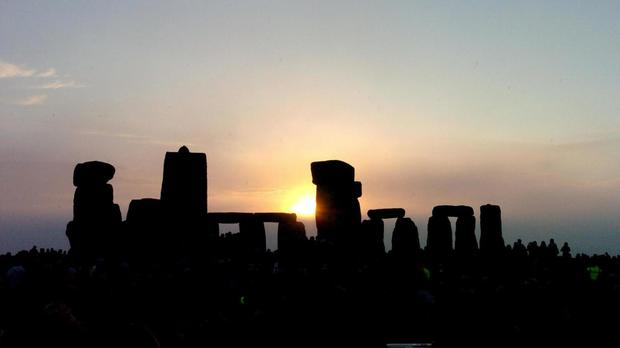 The sun rising over Stonhenge in Wiltshire at dawn