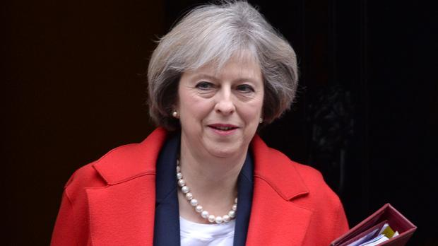 Prime Minister Theresa May posed a question about the roses in her garden