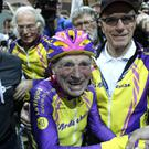 Robert Marchand, 105, is cheered after setting a record for distance cycled in one hour at the velodrome of Saint-Quentin en Yvelines, outside Paris (Thibault Camus/AP)