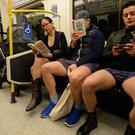 Passengers join the No Pants Tube Ride on the London Underground