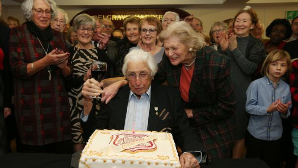 Britain's oldest living Olympian Bill Lucas celebrates his 100th birthday alongside his wife Sheena (centre right) at Belgrave Harriers running club in Wimbledon, London.