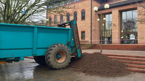Workers clear up after muck was sprayed on the steps of Derby Crown Court