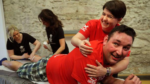 Tory leader Ruth Davidson lends some support to her MSP Miles Briggs, as he has a leg wax to raise money for the Children's Hospice Association Scotland