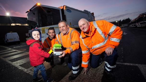 Jack Beswick, two, with - from left to right - binmen Paul Hardy, Keith Holden and Michael Plant (Durham County Council/PA)