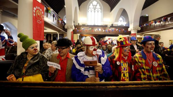 Clowns attend the Clowns International annual Joseph Grimaldi memorial service
