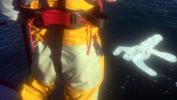 The white protective suit that was recovered after the RNLI Peterhead Tamar Lifeboat was launched, at the request of UK Coastguard (RNLI/PA)