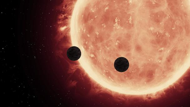 Astronomers have detected at least seven Earth-sized worlds orbiting cool dwarf star TRAPPIST-1 (Massachusetts Institute of Technology/PA)