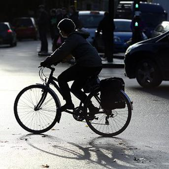 The law would see drivers fined €80 and given three penalty points if they are caught overtaking cyclists at a distance of less than 1.5 metres. Photo: PA