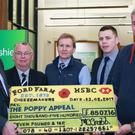 A cheque made entirely of cheese was presented to the Royal British Legion by a farm that sold cheddar in the shape of poppies (Royal British Legion)