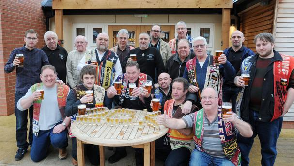 The Black Country Ale Tairsters celebrate visiting their 20,000th pub at the Knot and Plough in Stafford after setting off on a pub-crawl three dacades ago