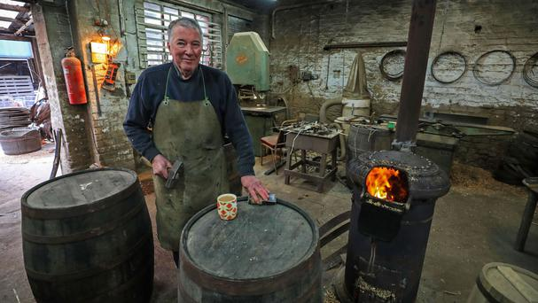Les Skinner, 72, who is the oldest cooper in England, at his cooperage in Bootle, Liverpool