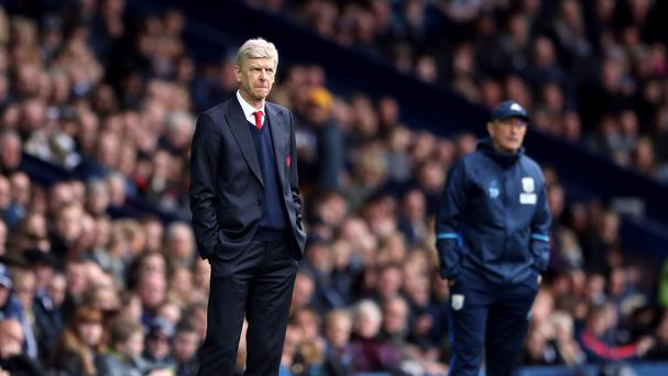 Arsenal manager Arsene Wenger and West Bromwich Albion manager Tony Pulis (background) during the Premier League match at The Hawthorns, West Bromwich.