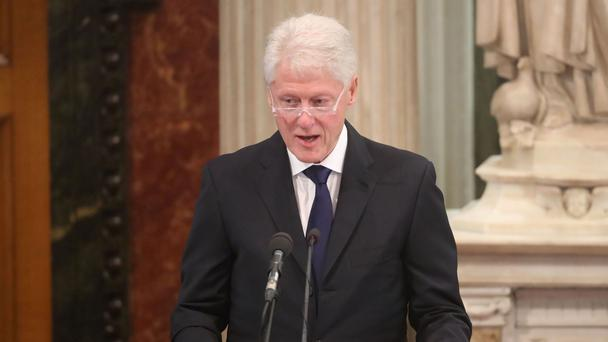 Former US President Bill Clinton speaks during the funeral of Northern Ireland's former deputy first minister and ex-IRA commander Martin McGuinness at St Columba's Church Long Tower, in Londonderry.