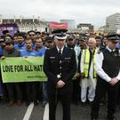 Superintendent Jon Williams (centre) joins a vigil held on Westminster Bridge in London, exactly a week since the Westminster terror attack took place.