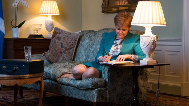 Handout photo issued by the Scottish Government of First Minister Nicola Sturgeon in the Drawing Room in Bute House, Edinburgh, working on the final draft of her Section 30 letter to the Prime Minister Theresa May formally requesting a second Scottish independence referendum.