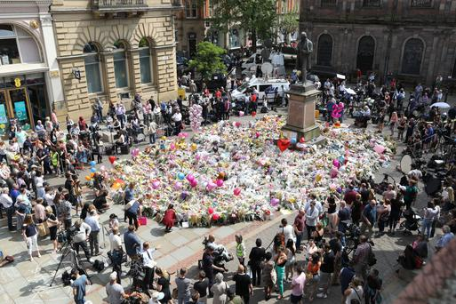 Tributes in St Ann's Square, Manchester, to remember the victims of the terror attack in the city earlier this week. Picture: PA