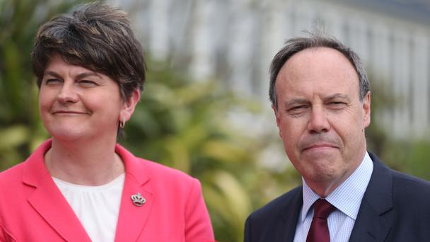 UK's May holds alliance talks with NIreland party chief