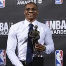 Russell Westbrook with his NBA MVP trophy (Evan Agostini/AP)