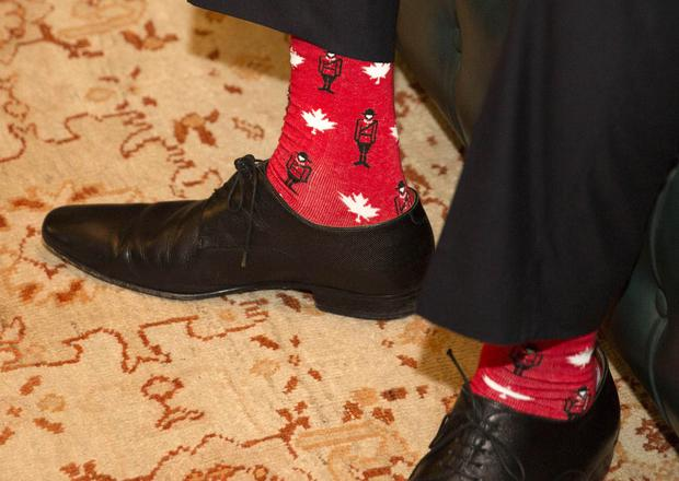 The socks feature Mounties and Canadian maple leaves (Kenneth O'Halloran/PA)